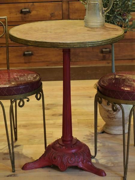 this art nouveau bistro table sits on a red cast iron stand the rh pinterest com
