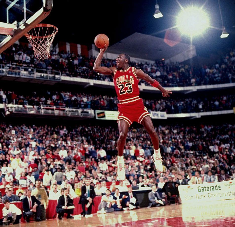 3e9e1bd8279f Michael Jordan takes off from the free-throw line to earn a perfect score  and win the 1988 Slam Dunk Contest. Jordan