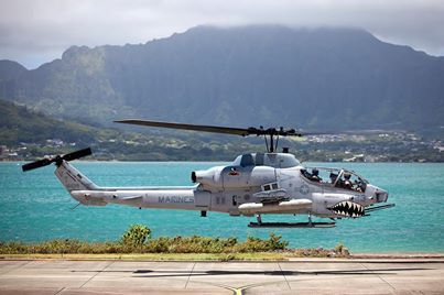 In the photo: An AH-1W Super Cobra helicopter departs the Marine Corps Air Station Kaneohe Bay, Hawaii, flightline on a maintenance and readiness flight, June 13, 2013. (Photo courtesy of U.S. Marine Corps)