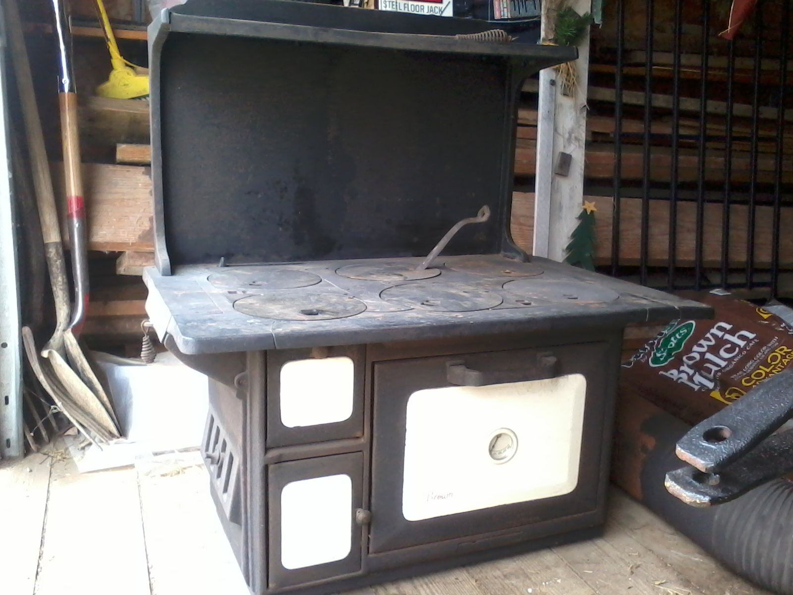 Antique coal & wood stove to put in garden shed