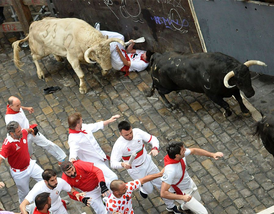 AFP/Getty Images Participants run beside Jandilla's fighting bulls during the fifth bull run of the San Fermin festival in Pamplona  Participants run beside Jandilla's fighting bulls during the fifth bull run of the San Fermin festival in Pamplona