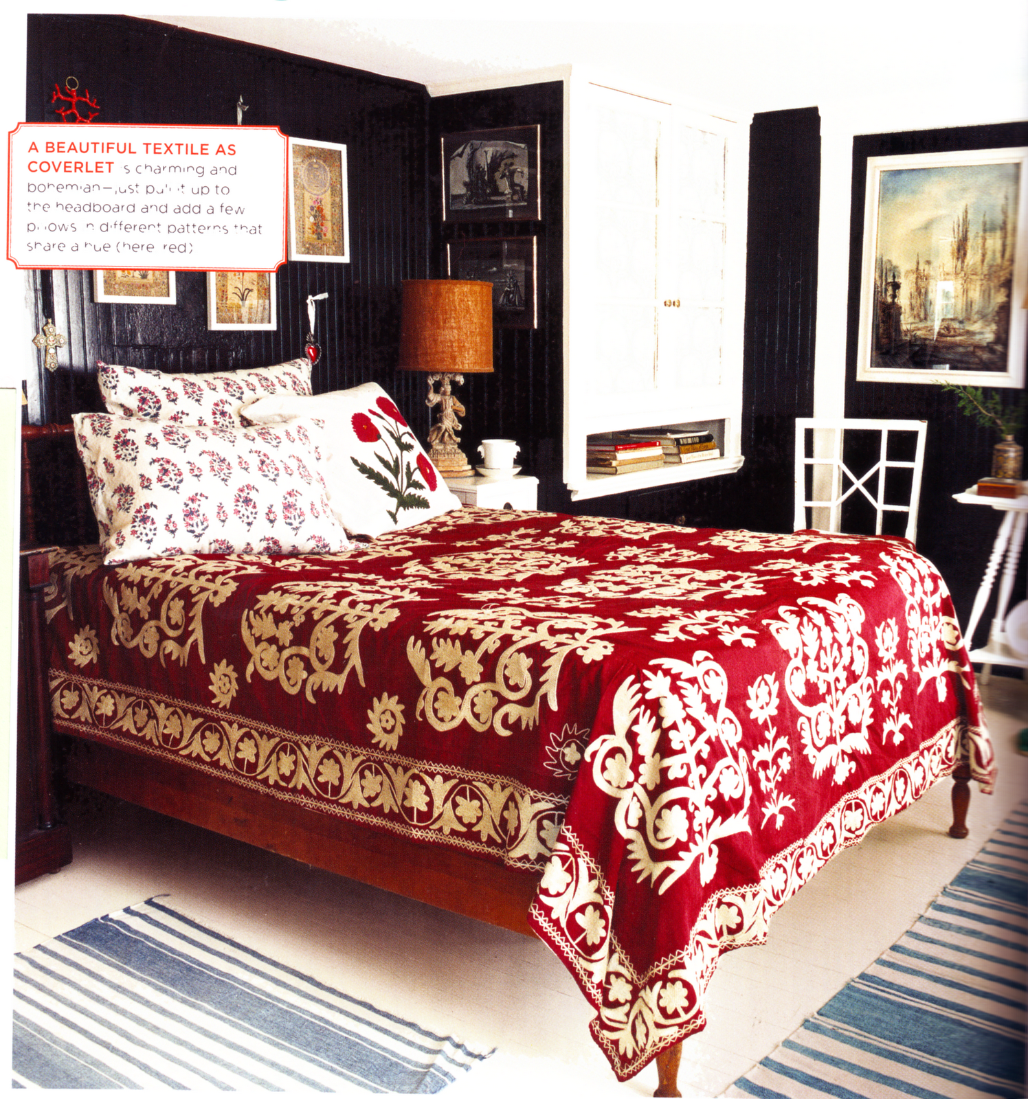 Red and black themed bedroom textiles by