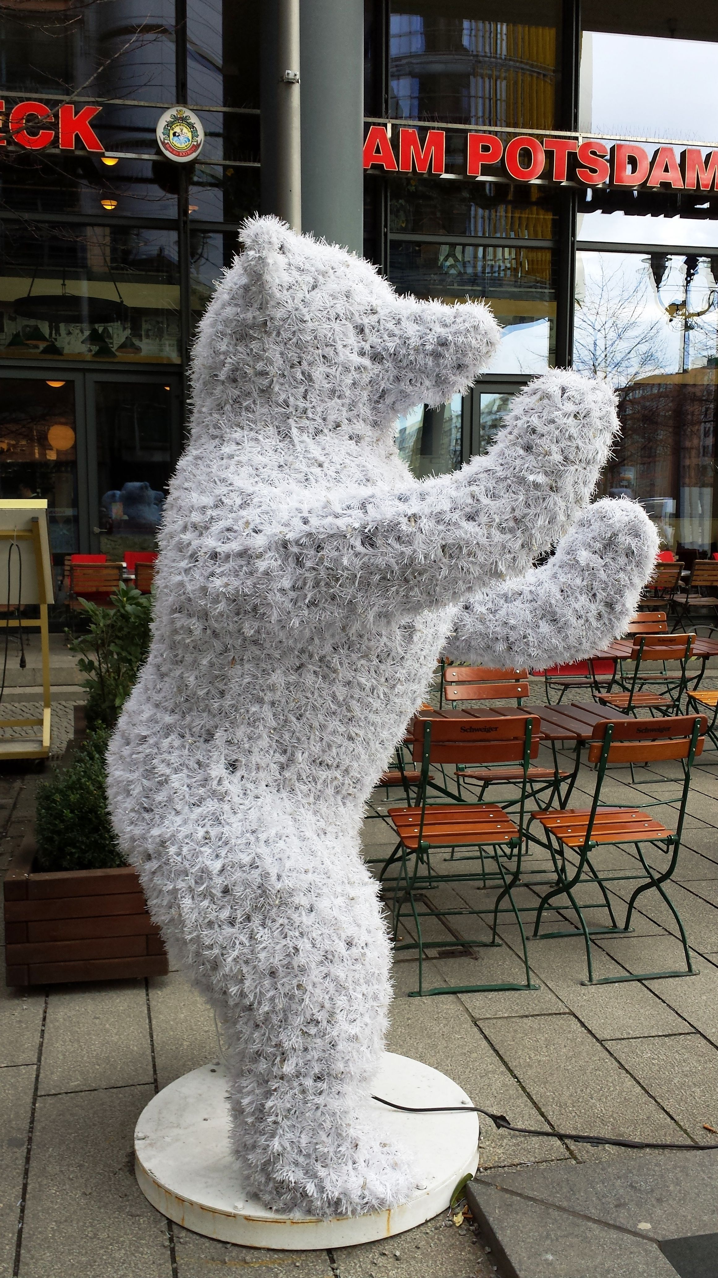 Cheerful ambassadors for berlin buddy bears outside house of 100 beers