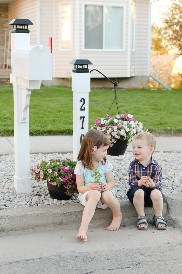Upgrade your curb appeal by giving your mailbox a makeover! Step by step instructions for this cottage style customized mailbox and address post with lanterns. #camitidbits #mailbox #mailboxmakeover #mail #curbappeal