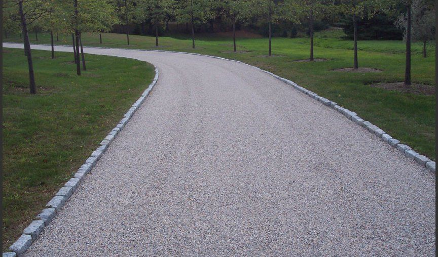 How To Create A Low Maintenance All Gravel Driveway Gravel Driveway Driveway Landscaping Landscaping On A Hill