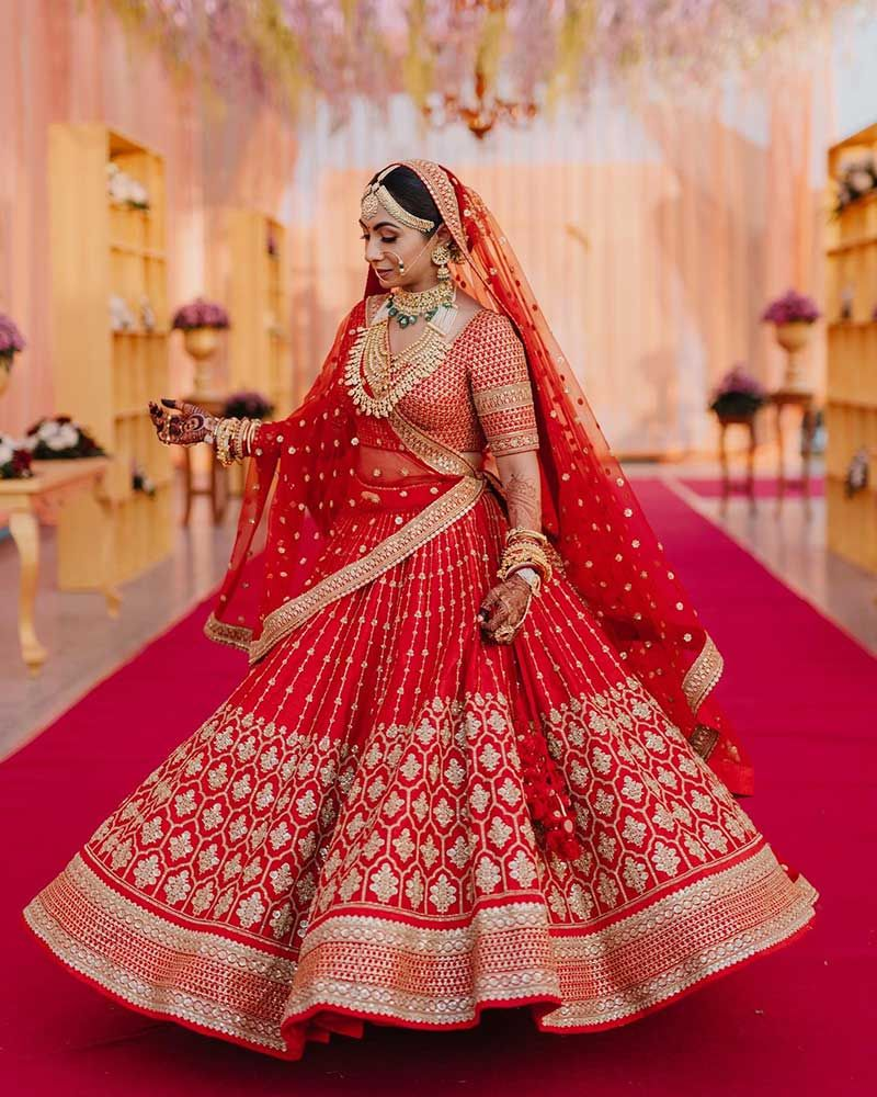 A Beautiful Wedding In Ahmedabad Where The Bride Wore Some Of The Most Gorgeous Outfits Ever Sha In 2020 Indian Bridal Outfits Indian Bridal Dress Bridal Lehenga Red