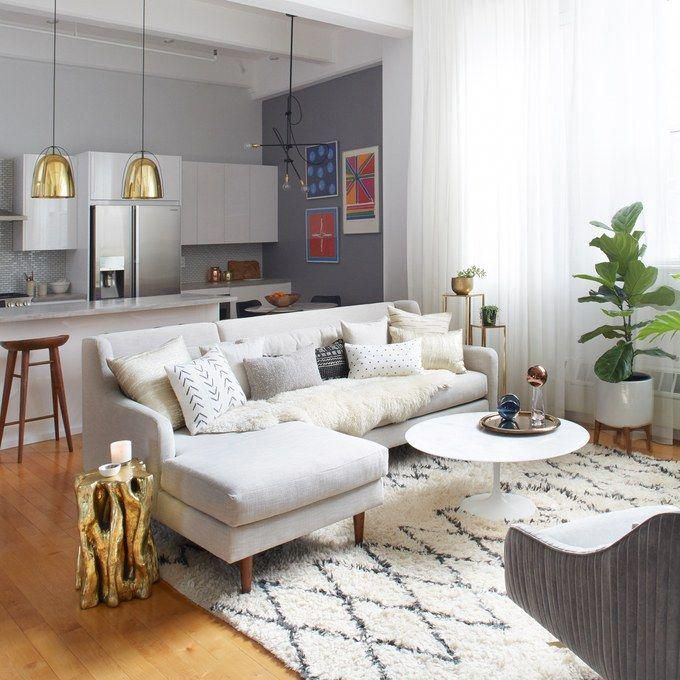 well designed kitchen and living area with brass accents seems to be rh pinterest com