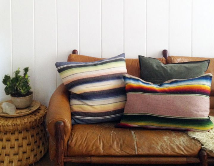 Serape blanket pillows on a worn leather couch...with a hint of ...