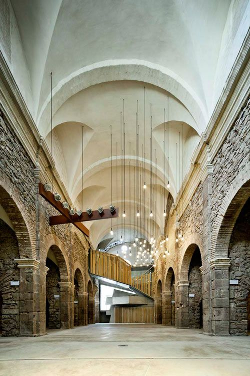 """""""This neglected church, once part of the Sant Francesc Convent, was renovated by Catalan architect David Closes. Located in the town of Santpedor, Spain, it was the last building standing from the convent and was badly in need of repair. The project turned the former church into an auditorium and multifunctional space for cultural events.""""  via Design Milk"""