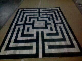 Beautiful cowhide black and white patchwork rug. - MAVIYA EXIM
