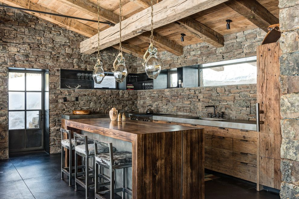 Mountain cabin inspired kitchen with stone walls