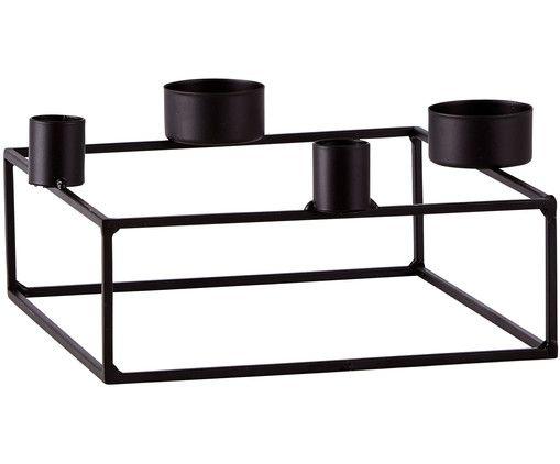 Kerzenlicht hoch vier: In Kerzenhalter FRAME finden gleich vier Kerzen Platz und erfüllen Ihr Zuhause mit sanftem Kerzenschein. Das luftige Metallgestell ist aus schwarz mattiertem Metall gefertigt.