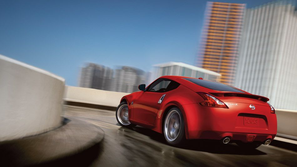2015 nissan 370z coupe sport tech in solid red driving away the rh pinterest com