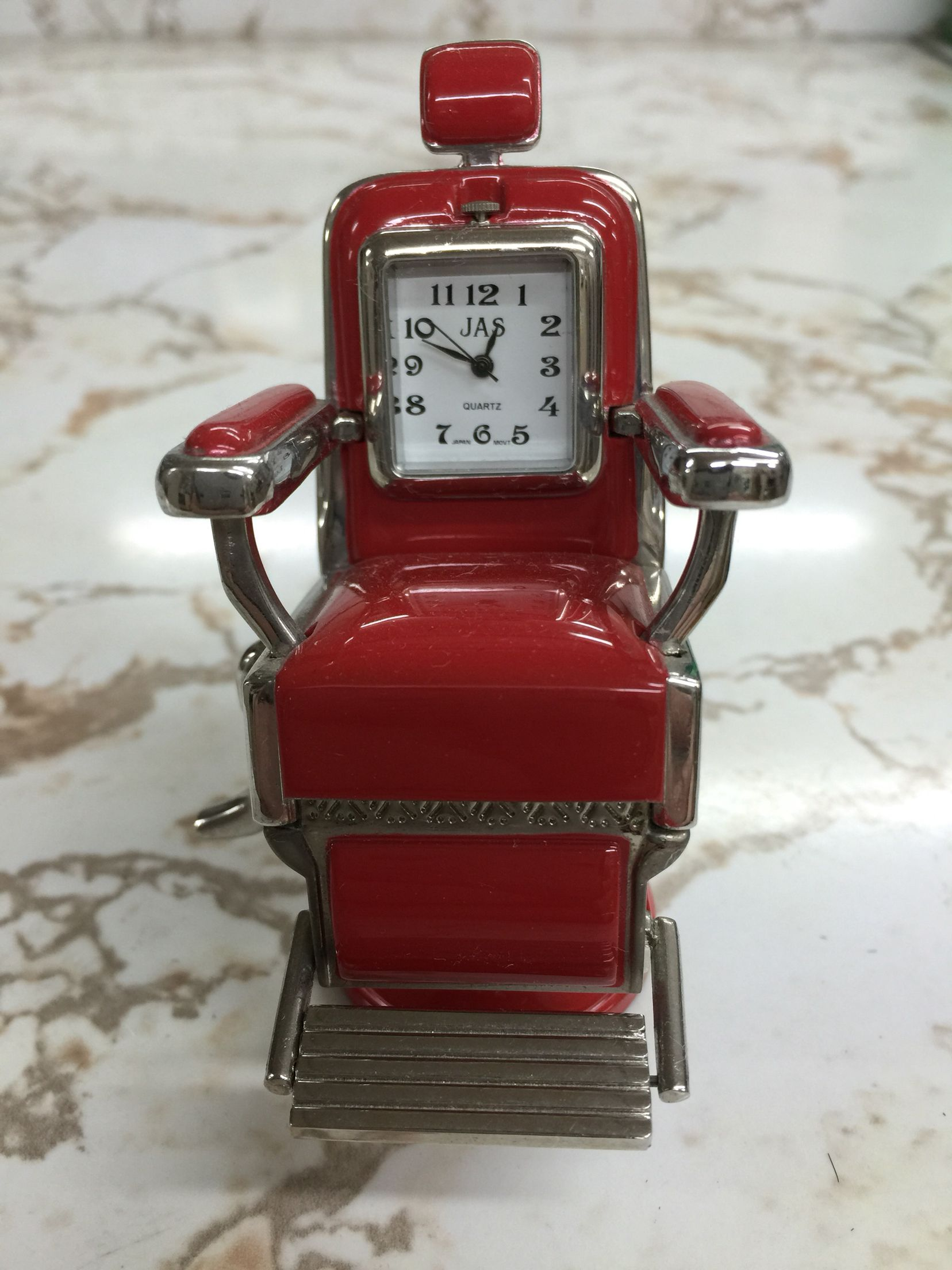Vintage clock barber chair Nunzio the Barber