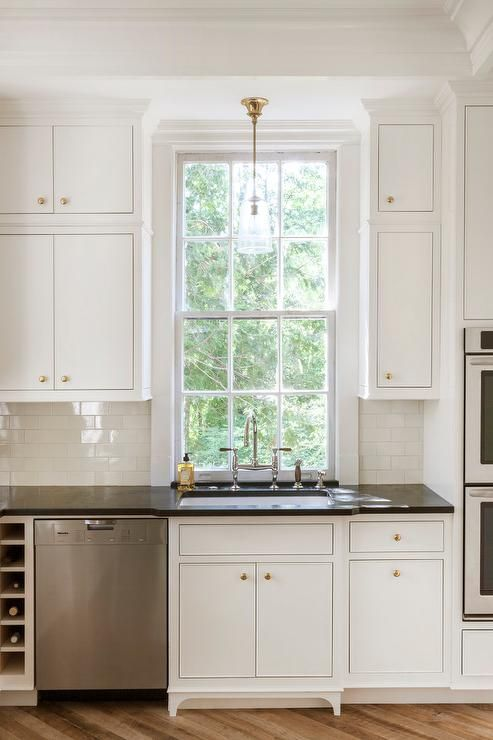 lovely kitchen features white inset cabinets adorned with brass rh pinterest com