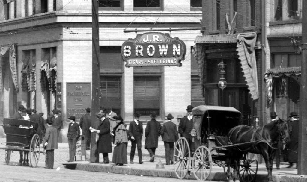 Horse and Buggy as well as electric street car was the primary modes of transportation at this time.  There are lots of bicycles in these old pics, too.  On the left you can see the corner of the First National Bank Building and on the right the J.R. Brown store.
