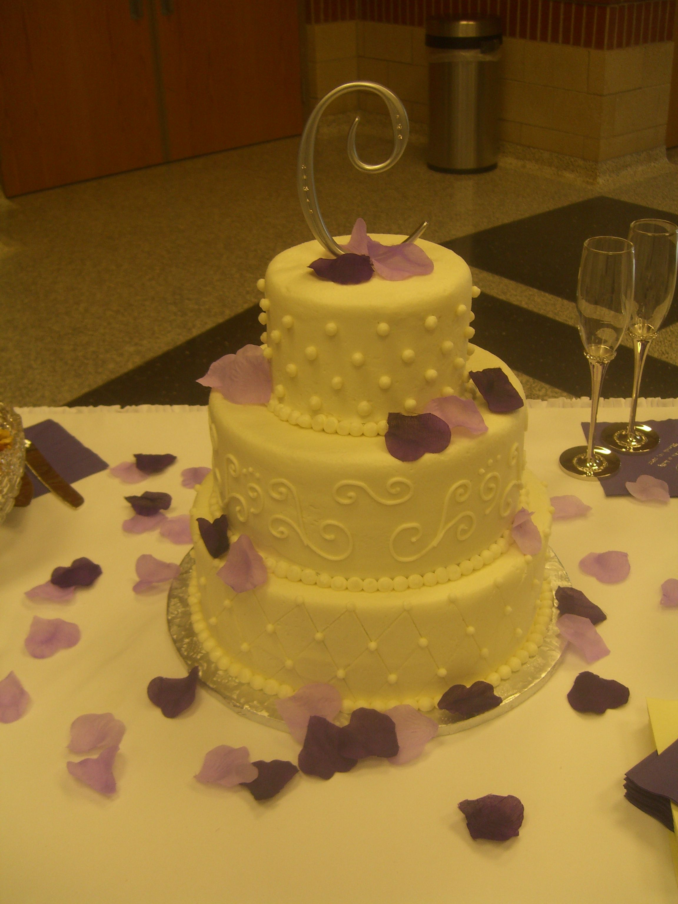 Wedding cake with purple rose petals, pearls, and scrolls by C ...