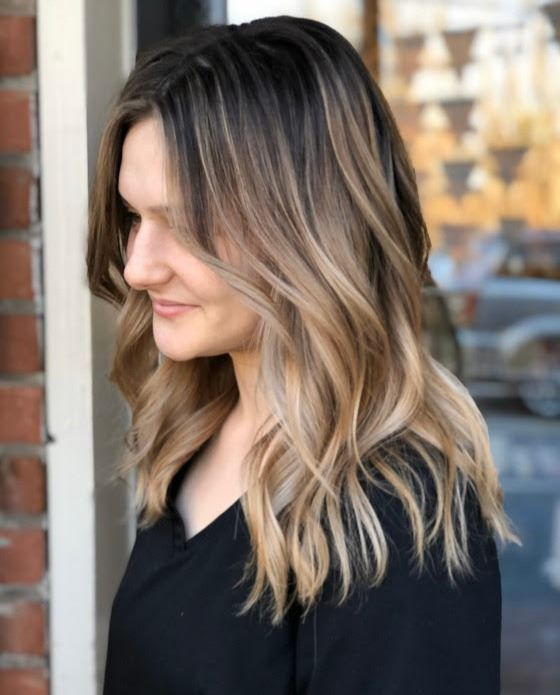 Seamless colormelt created by Stylist Brittany.   Call 410-795-9465 to reserve today!   #balayage #colormelt #handpainted #blonde #blondehair #healthyhair #redken #redkenready #highlights #eossalon