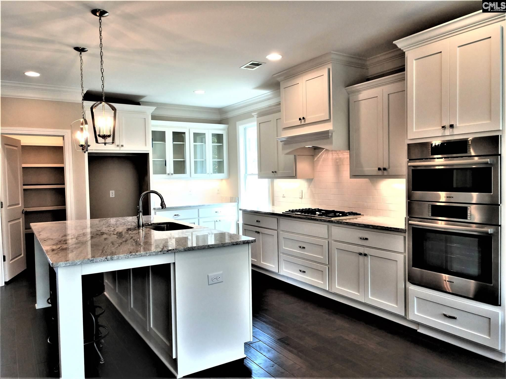 Abhe gourmet custom kitchen featuring built in
