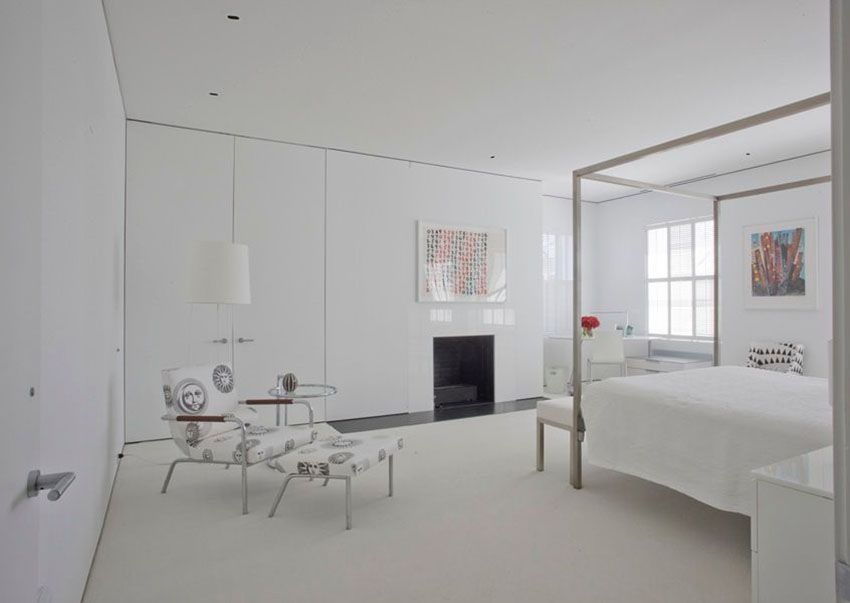 modern bedroom designs%0A Modern bedroom with high glass white builtin storage walls and metal  canopy bed