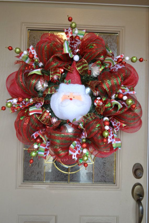 Santa Mesh Wreath via EtsyI think I