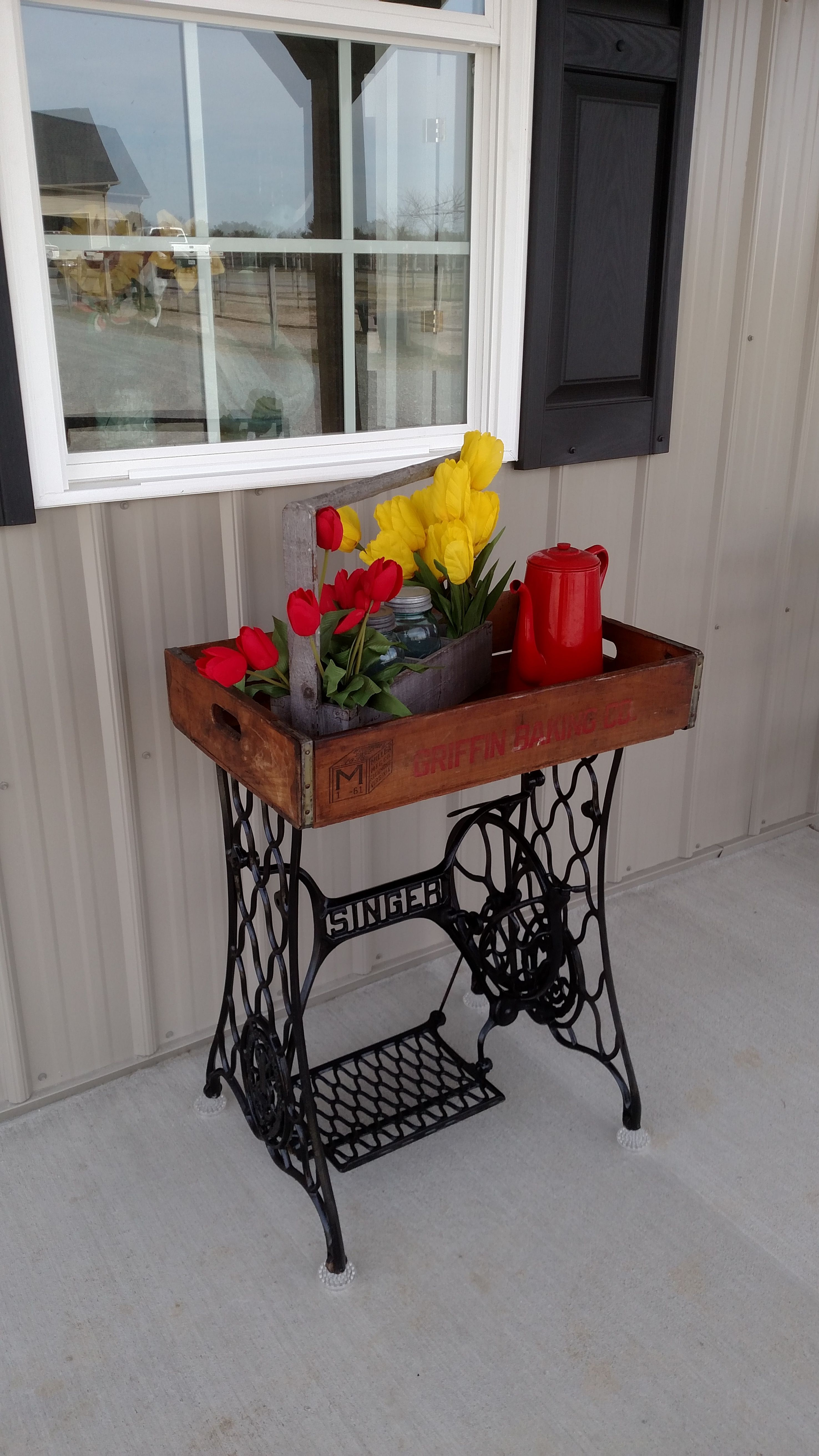 table i made from singer sewing machine base and an old crate crate can be