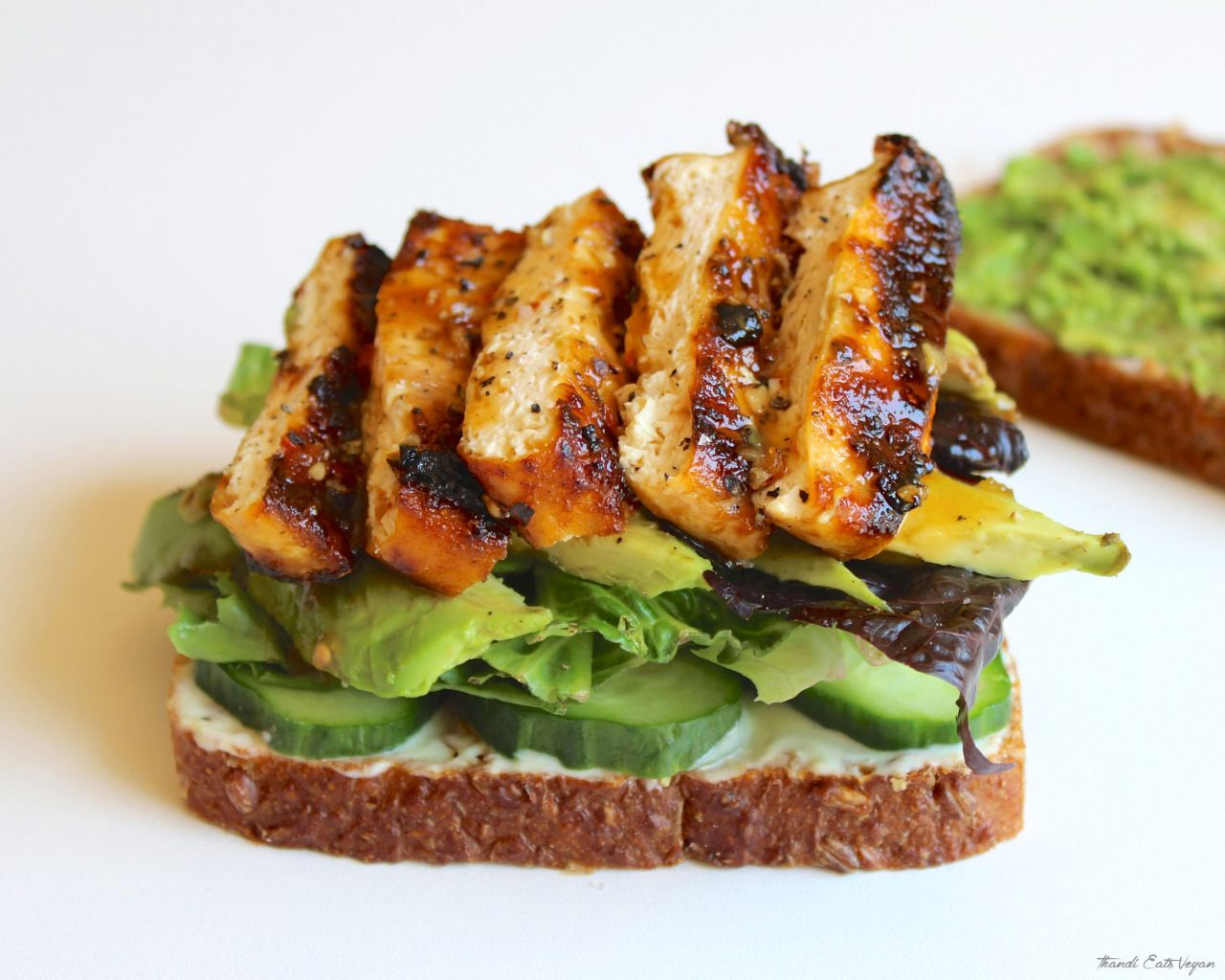thandieatsvegan:  Grilled Sticky Tofu Sandwich Grilled firm tofu served on whole-grain bread with avocado, mixed romaine lettuce and cucumber. Thandi Eats Vegan| Instagram