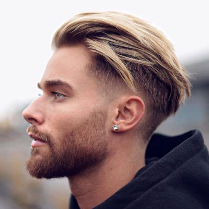 Attractive Low Taper Fade With Textured Slick Back And Full Beard
