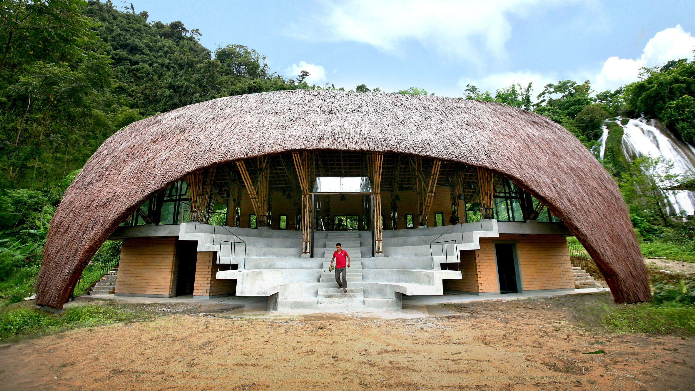 This Community Centre Designed By 1 1 2 Architects In Vietnam Features A Bamboo Framework And Thatched Roof T Community Housing Roof Architecture Thatched Roof