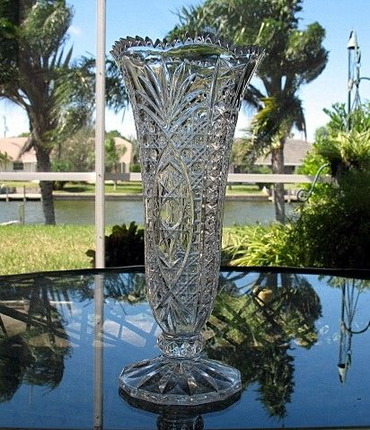 This is a stunning lead crystal vase made in the early 1900s by Imperial. It glows gray white under a UV. It is made of heavy thick crystal.