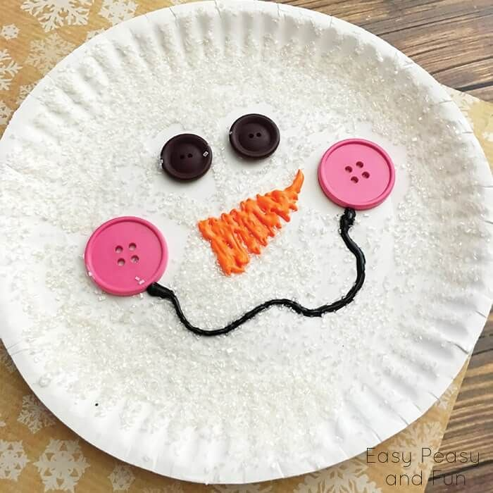 Paper Plate Snowman- Use Modge Podge to paint your plate then sprinkle with glitter, use a low temperature glue gun to attach buttons and puffy paint for the nose and smile.