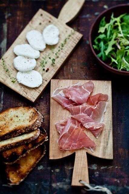 Prosciutto, mozzarella, arugula on toast. Simple European snack.