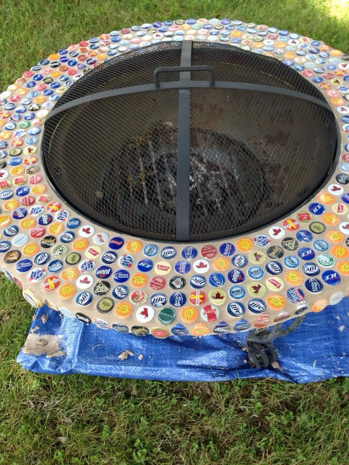 Refurbished Fire Pit With Beer Bottle Caps From Prior Fire Pit Gatherings Bottle Cap Projects Beer Caps Bottle Cap