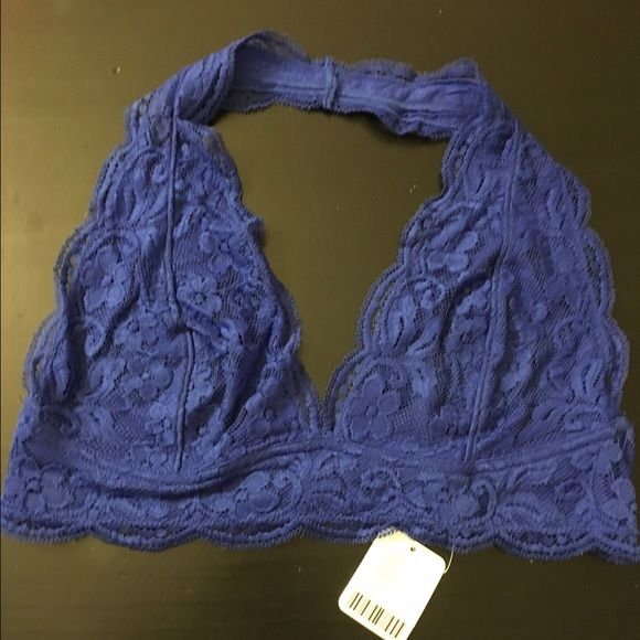"""Cobalt lace halter bra Soft and gorgeous cobalt blue lace halter bra from Urban Outfitters. Size large, stretchy and flexible material, site says it fits 38B. Please check out the reviews on Urban's website for size questions, it's called """"out from under lace halter bra"""" Never worn, tags attached! Urban Outfitters Intimates & Sleepwear Bandeaus"""