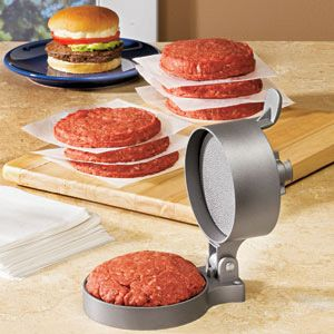 "HAMBURGER PRESS. Make perfectly shaped patties in no time! Non-stick burger press molds a 4-1/2"" diameter, bun-sized patty with the ground meat of your choice. Just place a ball of meat inside and close firmly - spring-loaded design shapes patties of any thickness from 1/4"" to 1-1/2"". Heavy-duty aluminum with non-stick coating assures easy release and quick clean-up. Also available: set of 350 parchment squares to separate shaped patties for freezing."
