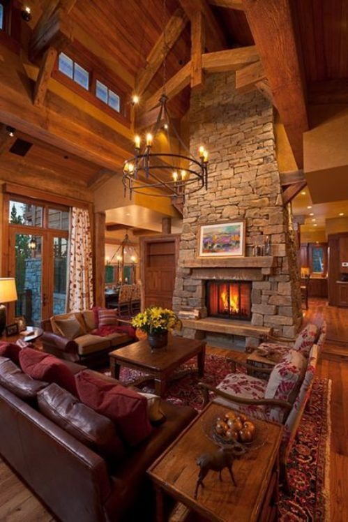 Cozy Cabin Living Room With Warm Wood Interior And A Stone Fireplace All Lit Up Loving This So Much