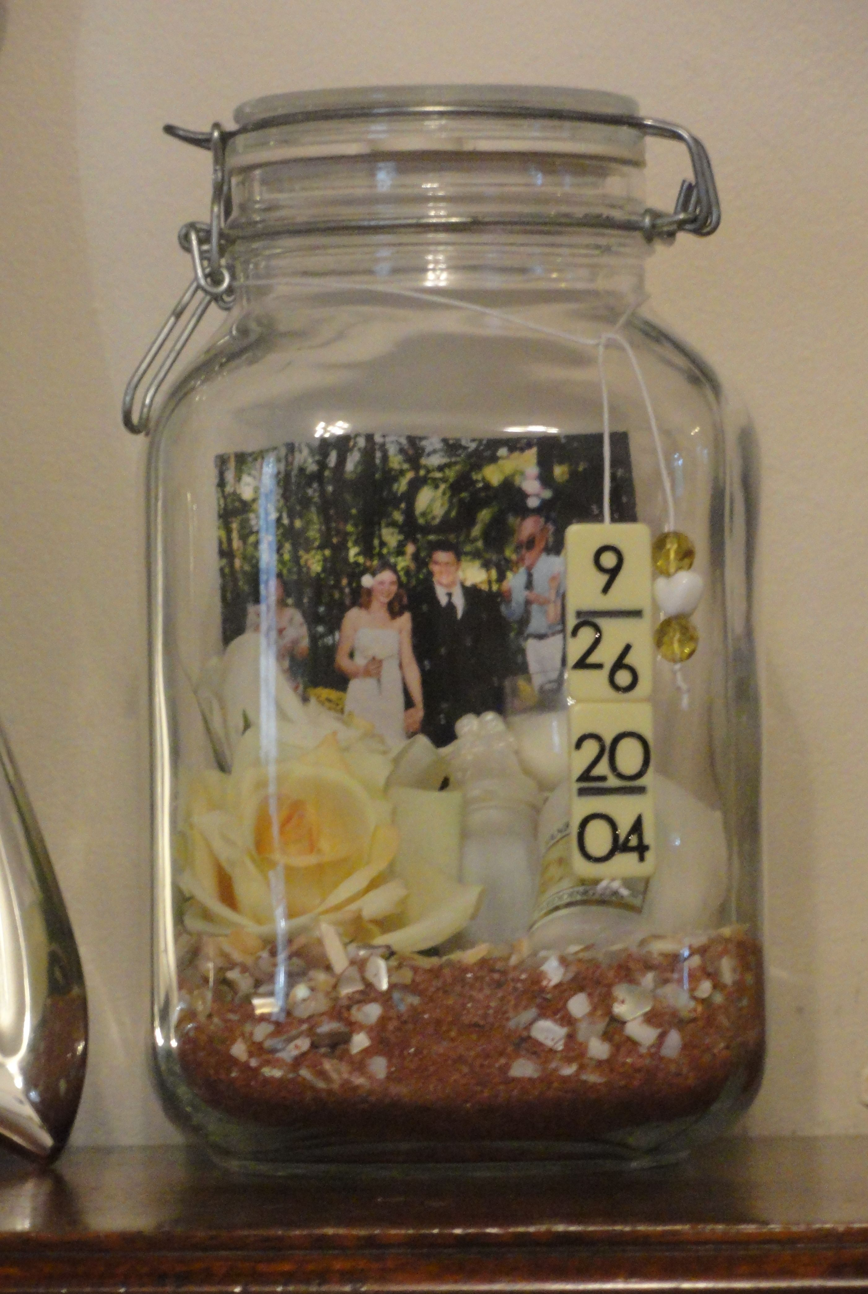 Wedding Memory Jar....filled with mementos & the date is made from blank domininos :)
