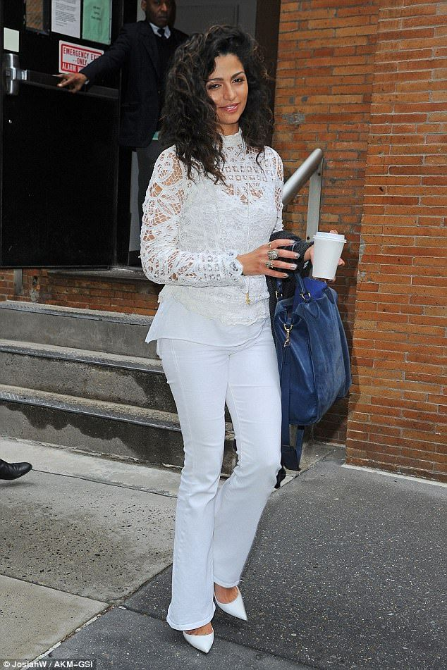 After a taping of The Chew: She'd been seen the previous day emerging from ABC, wearing a lacy white blouse sheer enough to give a glimpse at at her sleeveless white top; there was no umbrella handler here even though it did seem to be raining