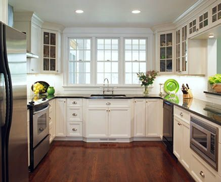 kitchencove.net perfect dark hardwood floors- clean white cabinets and dark countertops