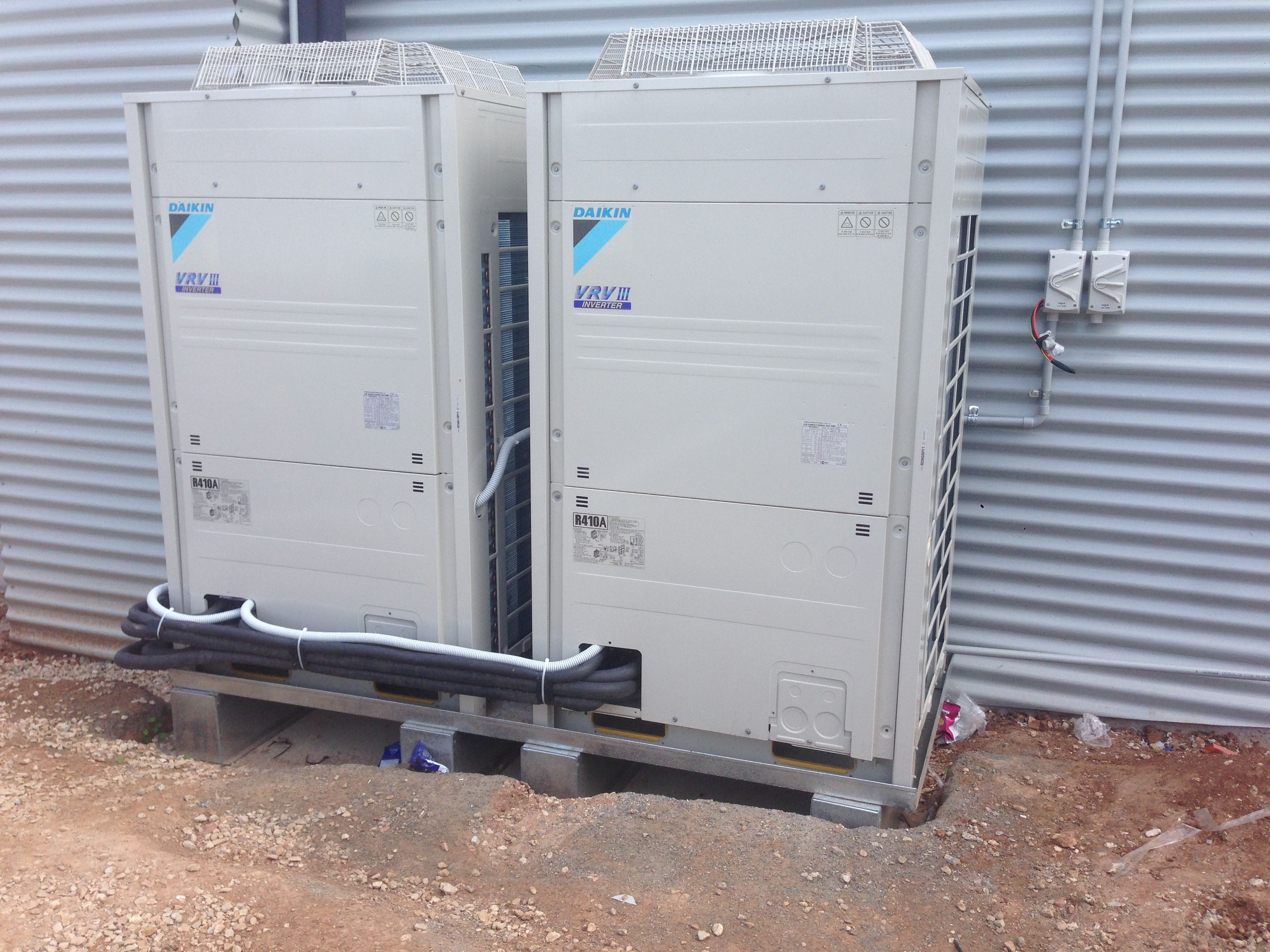 A couple of friendly Daikin units settling in for many