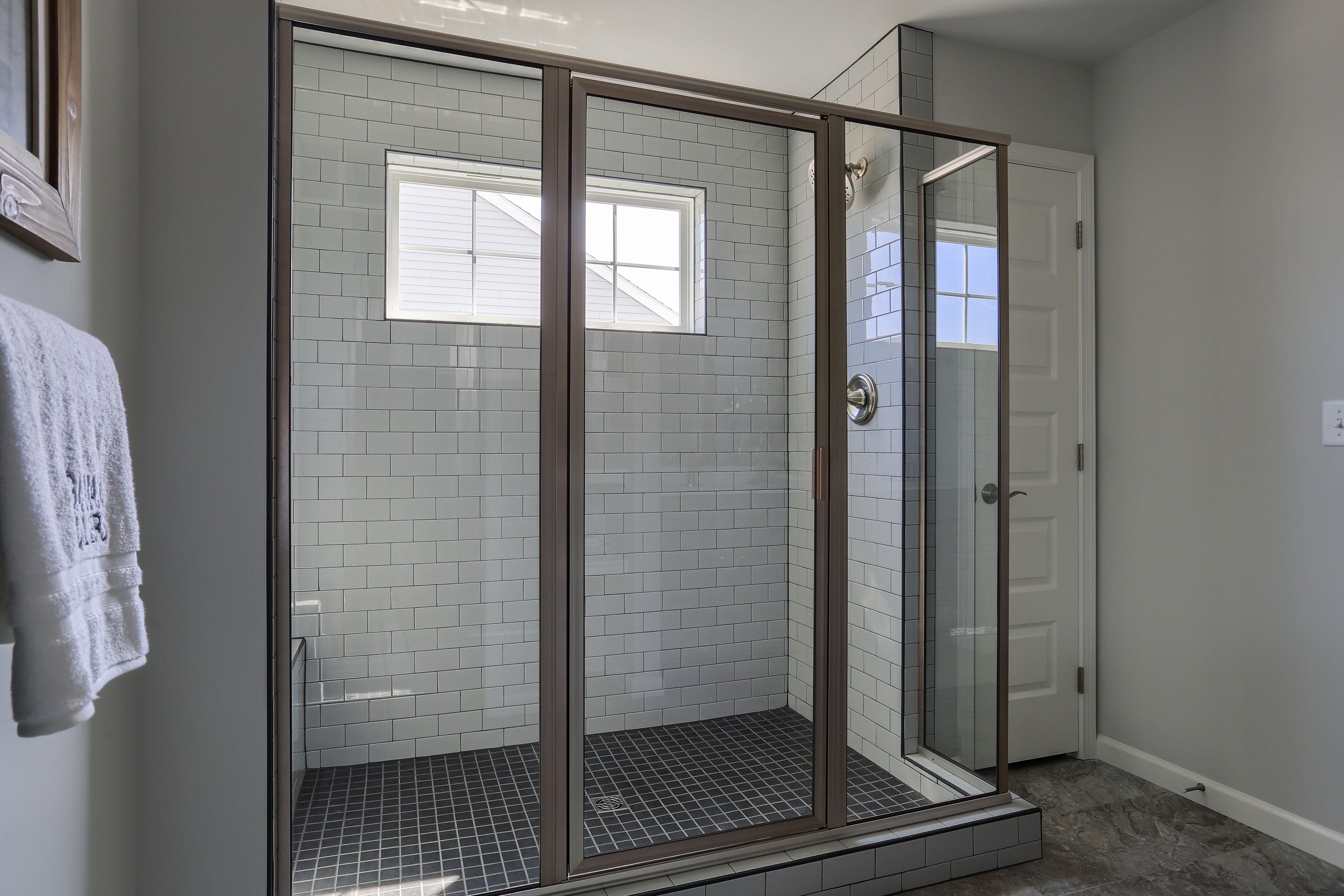 Brushed Nickel Framed Glass Door Glass Tile Shower Custom Homes Custom Home Builders