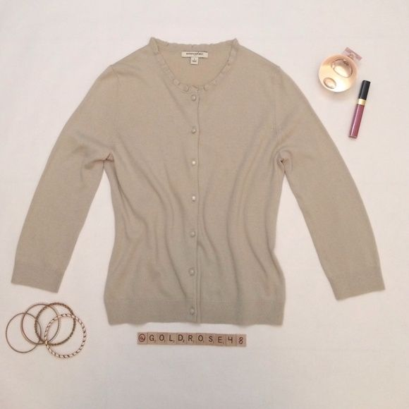 """Banana Republic tan cardigan Tan cardigan with opal-like buttons, size S, overall length 21"""", 40% rayon/30% nylon/23% cotton/7% angora rabbit hair, hand wash cold. No zippers or pockets. Worn once so it's in excellent condition. No damage/fraying/stains. Has been cleaned and stored in a non-smoking/pet-free home. Bracelets, perfume, lip gloss not included. No trades or PP. *15% off bundles of 2+ items!* Banana Republic Sweaters Cardigans"""