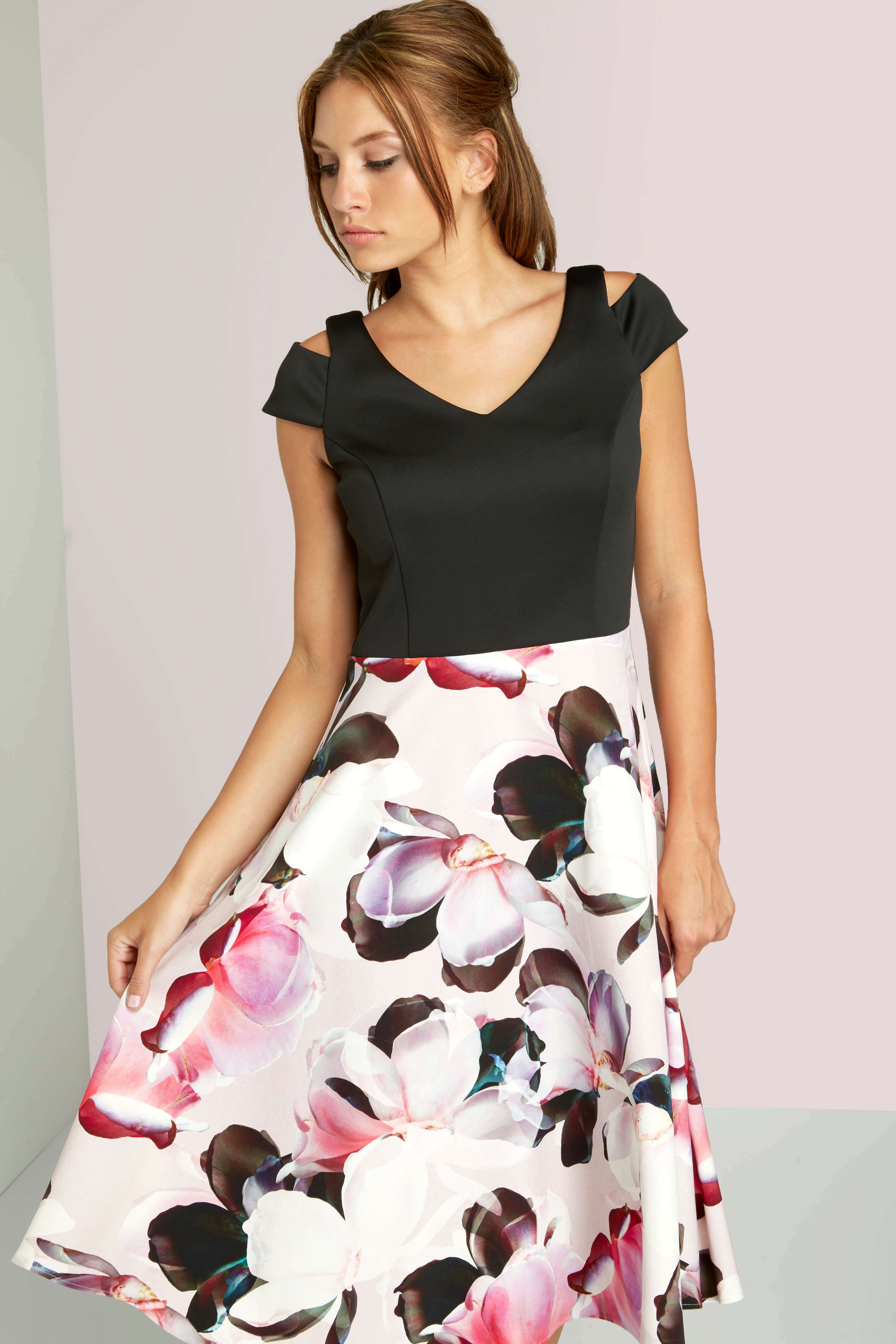 1b42f2b0fb Be a picture of modern femininity in this stunning fit and flare dress.