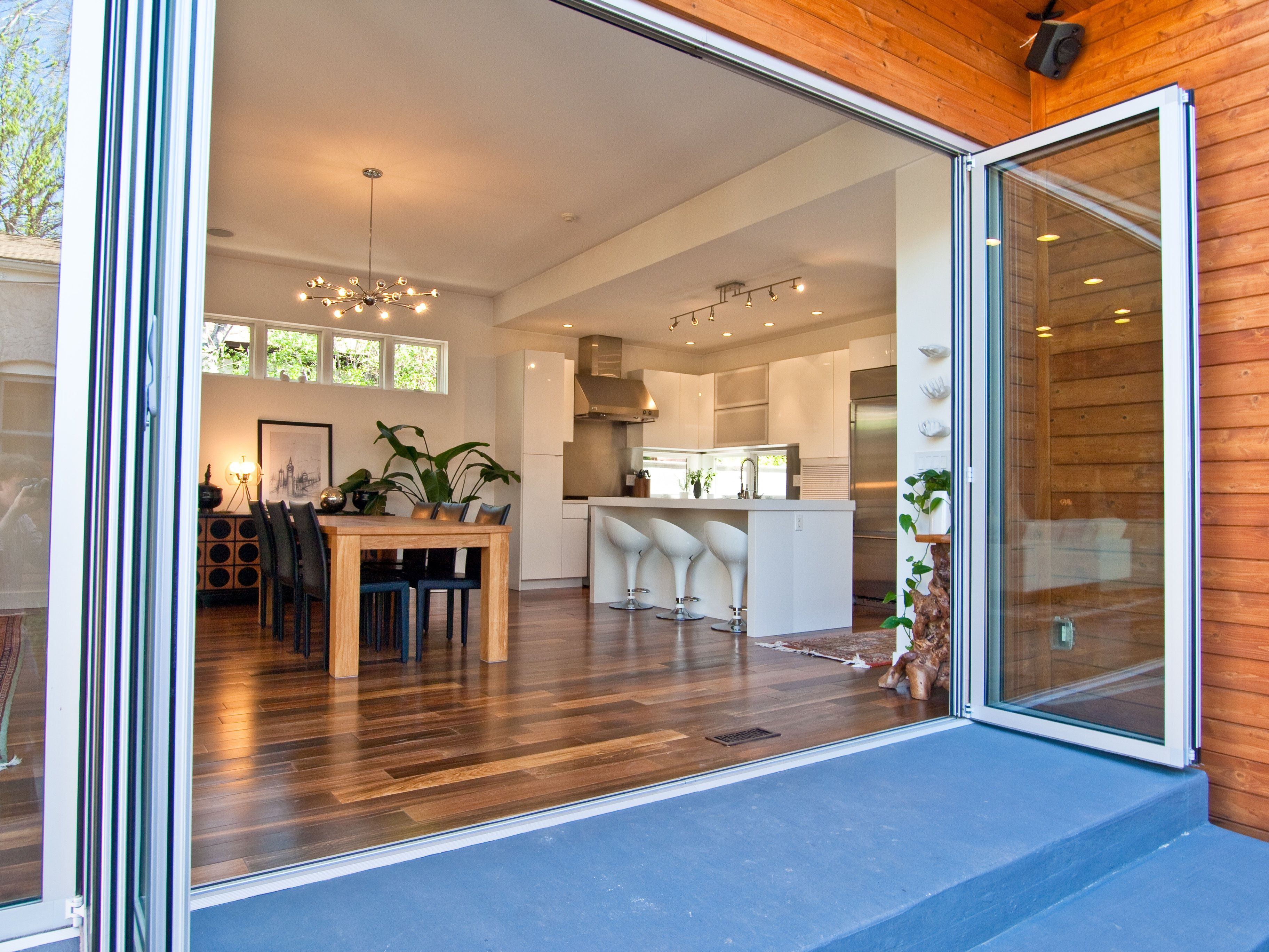 Nana glass wall system. Doors opening outside. Glass doors, glass wall. Indoor outdoor living.