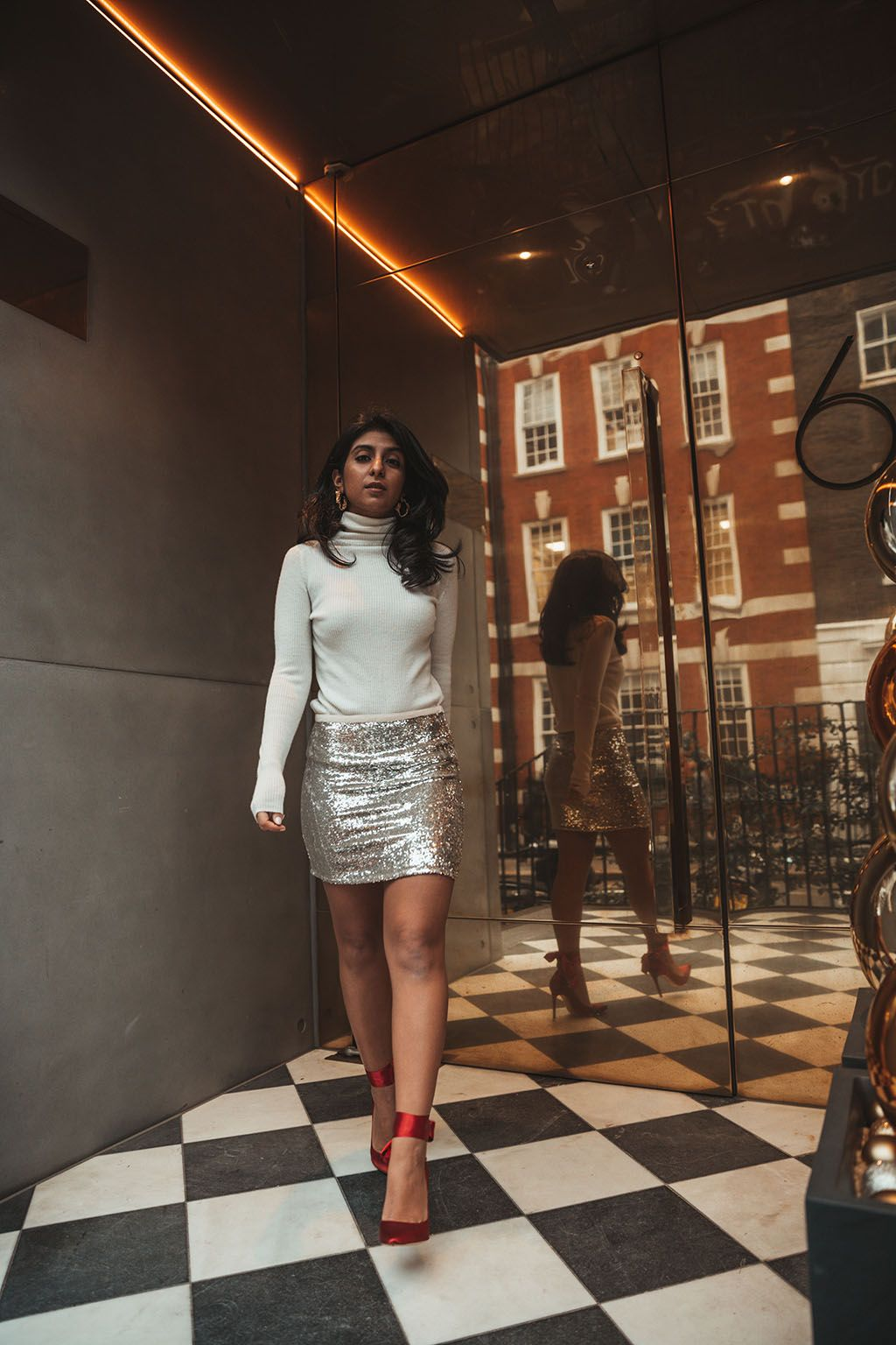 56aab600d14 Luxury fashion blogger Shloka Narang of The Silk Sneaker shares a holiday  party outfit idea featuring a sequins skirt from Topshop and Gianvitto  Rossi heels