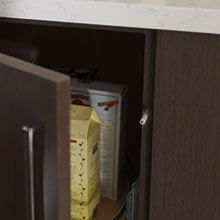 Touch latch cabinet entry system for doors and drawers by Omega Cabinetry