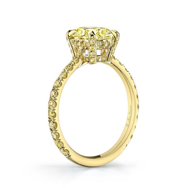 RIVIERA SOLEIL is a custom, traditionally handcrafted Jean Dousset Diamonds solitaire engagement ring set in 18K Yellow Gold with a Cushion cut Yellow diamond and Fancy Intense Yellow diamonds on the band. #YellowDiamond #YellowDiamond #YellowGold #EngagementRing