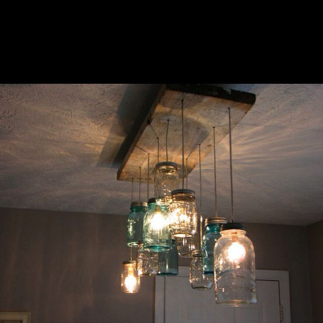I saw these on house hunters Mason Jars light fixtures cool