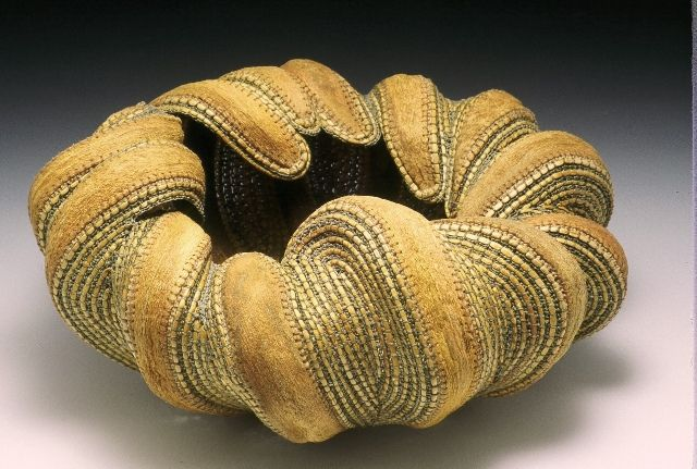 """Jan Hopkins -""""Within"""" – Dimensions: 6-1/2""""x13""""x13"""", Date: 2002, Materials: Alaskan yellow cedar, waxed linen, and agave leaves."""
