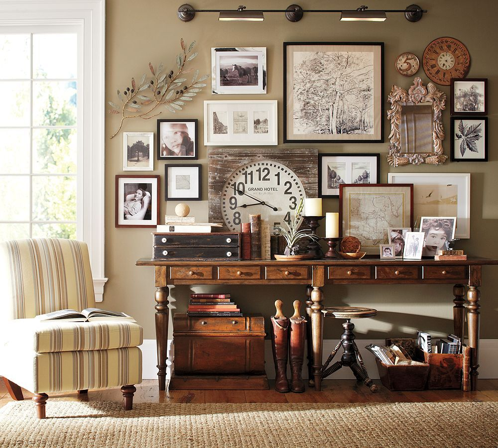 living room pottery barn%0A Gorgeous wall collage of pictures and other ephemera  from Pottery Barn    from